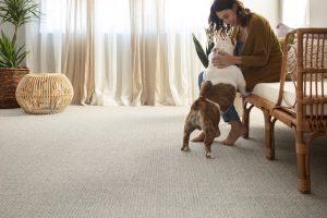Lady with dog on Carpet floor | Dalton Wholesale Floors