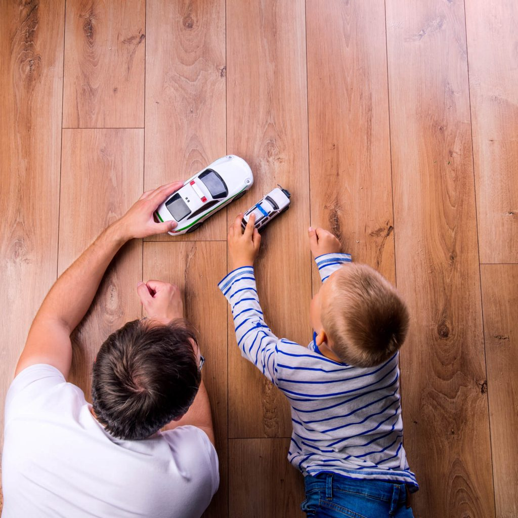 Father and kid playing with toycar | Dalton Wholesale Floors