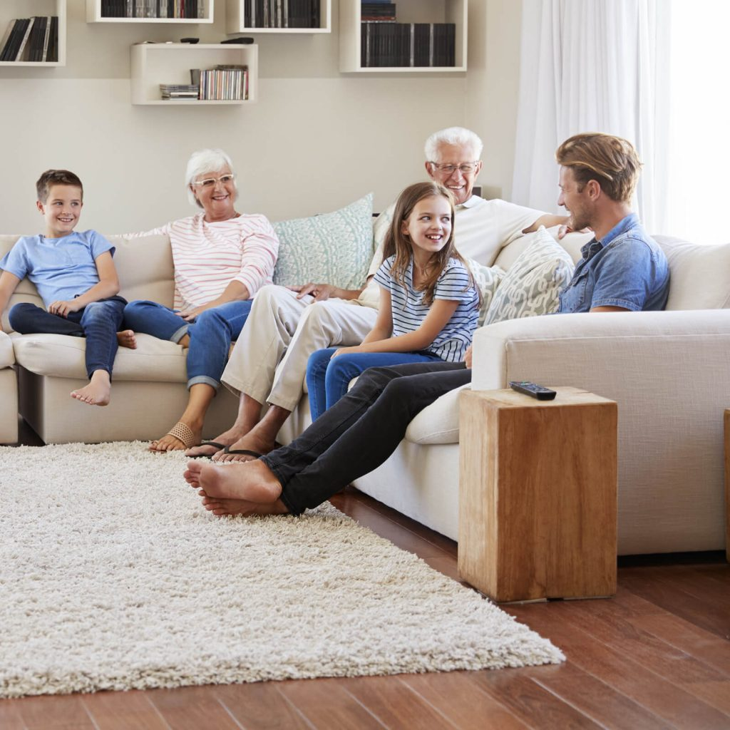 Family gosping in living room | Dalton Wholesale Floors